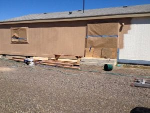 Painting siding on a mobile home